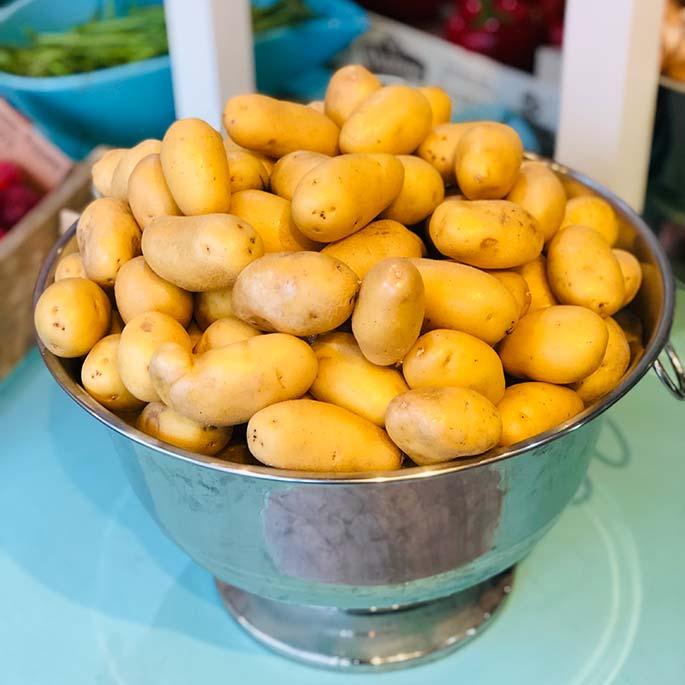 Metal bowl of potatoes